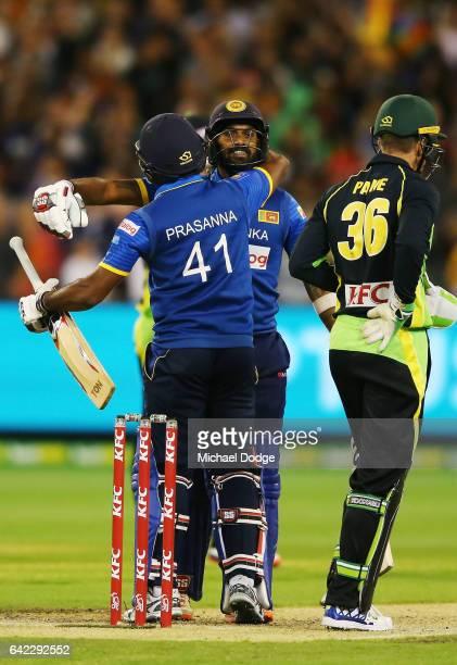 Seekkuge Prasanna of Sri Lanka hugs Chamara Kapugedera after he hit the winning runs during the first International Twenty20 match between Australia...