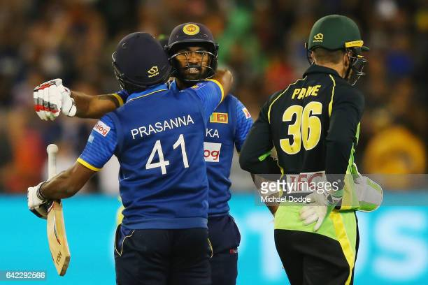 Seekkuge Prasanna of Sri Lanka hugs Chamara Kapugedera after he hit the winning runs during the first International Twenty20 match between Australia...