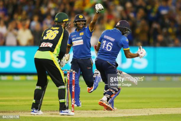 Seekkuge Prasanna of Sri Lanka reacts after Chamara Kapugedera hits the winning runs during the first International Twenty20 match between Australia...