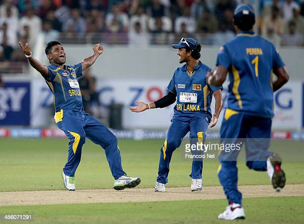 Seekuge Prasanna of Sri Lanka celebrates after dismissing Sharjeel Khan of Pakistan during the second Twenty20 International match between Pakistan...