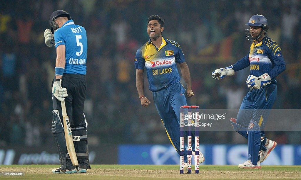 Seekuge Prasanna of Sri Lanka celebrates dismissing Joe Root of England during the 7th One Day International match between Sri Lanka and England at R. Premadasa Stadium on December 16, 2014 in Colombo, Sri Lanka.