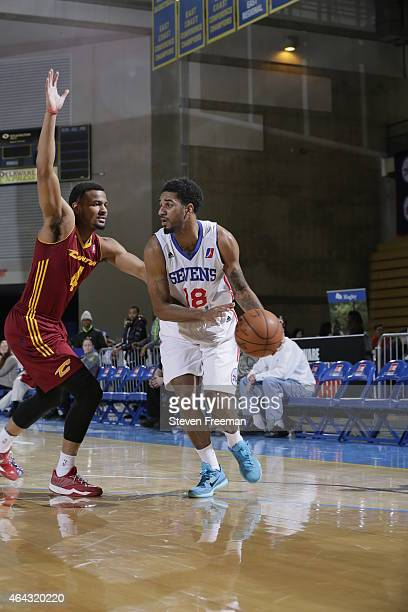 J Seeley of the Delaware 87ers drives against Chris Crawford of the Canton Charge at the University of Delaware Bob Carpenter Center on February 24...