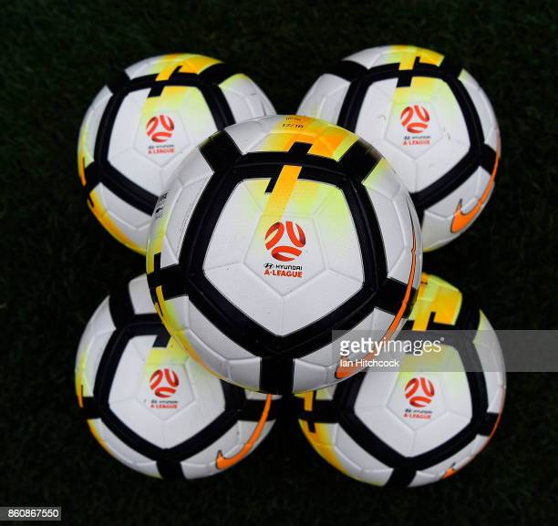 Seen are game balls on the field of play before the start of the round two ALeague match between the Brisbane Roar and Adelaide United at Suncorp...