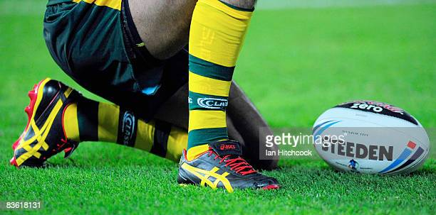 Seen are the boots of Johnathan Thurston of Australia in the colours of the Aboriginal flag during the 2008 Rugby League World Cup Pool 1 match...