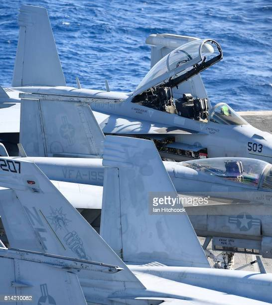 Seen are US Navy Super Hornets on the deck of the USS Ronald Reagan on July 14 2017 in Townsville Australia USS Ronald Reagan is a 1092 foot aircraft...