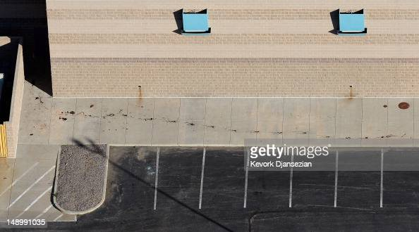 Seen from the air bloodstained footprints dot the back of the Century 16 movie theatre where suspect James Holmes went on a shooting rampage during...