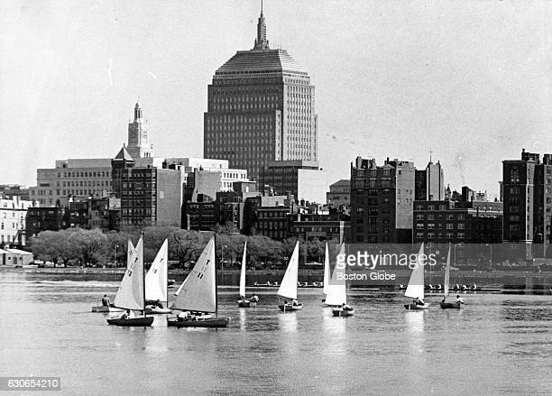 Seen from the Cambridge side of the Charles River sailboats pass by the Berkeley Building also known as the Old John Hancock Building on April 28 1969