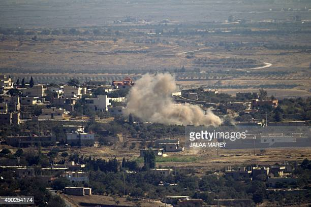 Seen from the hill village of Buqaata in the Israeliannexed Syrian Golan Heights smoke ascends from alleged shelling by Syrian government forces in...