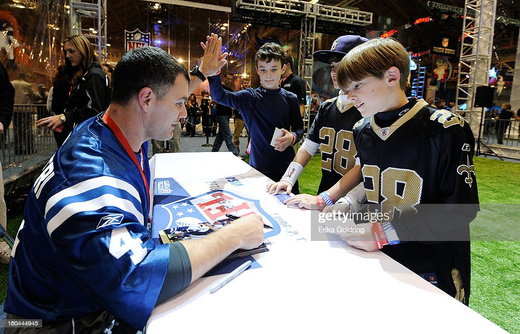 Seen here signing autographs for his fans, Colts placekicker <a gi-track='captionPersonalityLinkClicked' href=/galleries/search?phrase=Adam+Vinatieri&family=editorial&specificpeople=204211 ng-click='$event.stopPropagation()'>Adam Vinatieri</a>, a 4-time Super Bowl champion, kicks for a good cause as he teams up with Barclaycard US and the NFL Extra Points Credit Card to donate $10,000 for the Brees Dream Foundation on January 31, 2013 in New Orleans, Louisiana.