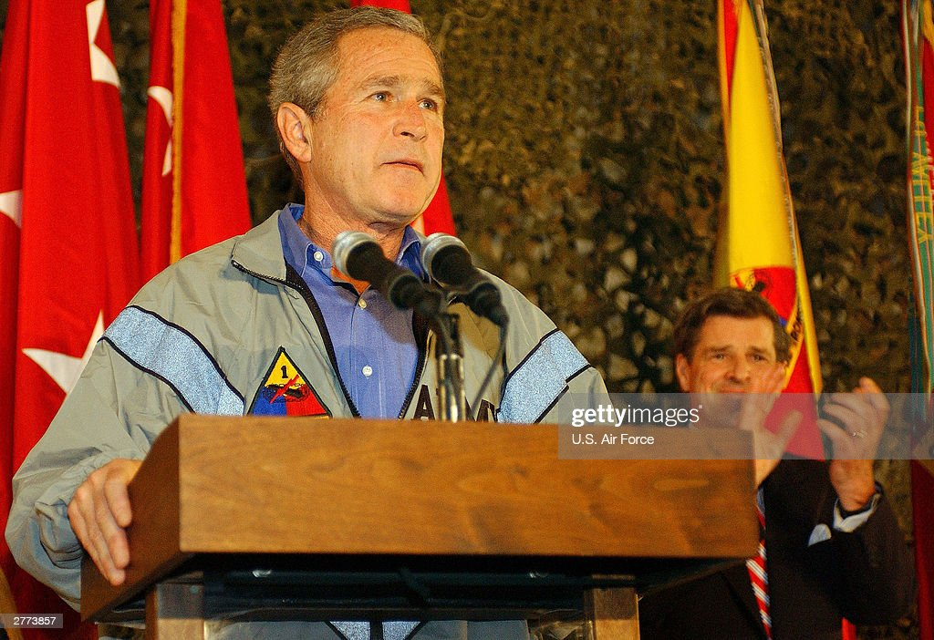 Seen in this handout photo provided by the U.S. Air Force, President George W. Bush speaks to the troops during a surprise visit on Thanksgiving Day, November 27, 2003 in Baghdad, Iraq.