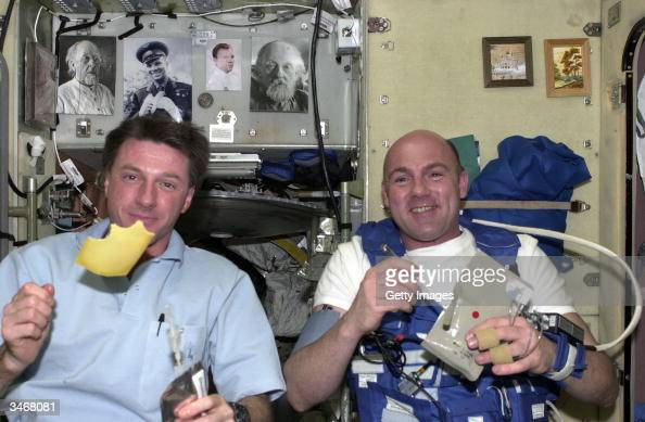Seen in this undated ESA handout out photo European Space Agency astronaut Andre Kuipers and his NASA colleague Michael Foale eat Dutch cheese for...