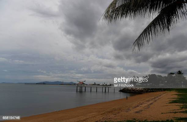 Seen is a general view of grey clouds over one of the Strand beaches with its jetty as residents prepare for Cyclone Debbie on March 27 2017 in...