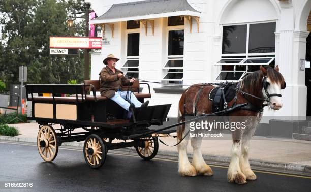 Seen is a man riding in a horse drawn carriage along the streets on July 09 2017 in Rockhampton Australia