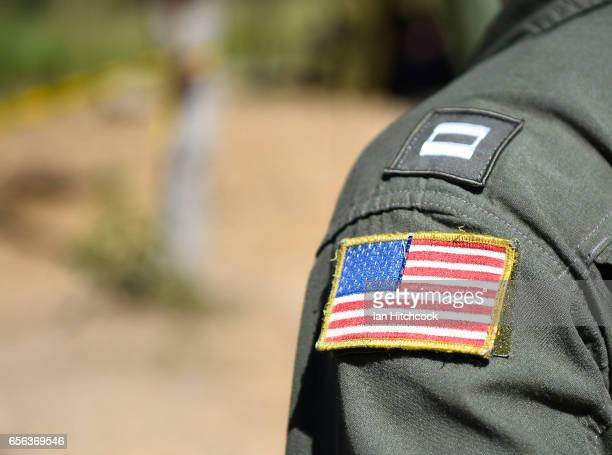 Seen is an American flag patch worn on a uniform of a United States Navy pilot from the VFA27 squadron during air operations on March 22 2017 in...