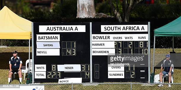 Seen is the scoreboard with attendants during the match between Australia 'A' and South Africa 'A' at Tony Ireland Stadium on August 7 2014 in...