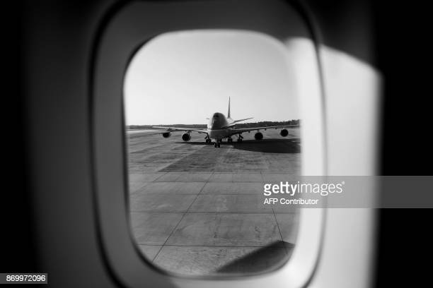 Seen through the window of Air Force One while taxiing the second 'Air Force One' used for support personnel is seen on the tarmac at Andrews Air...
