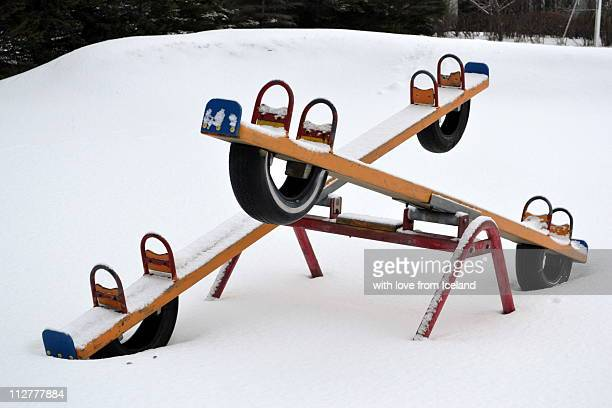 Seesaw in snow