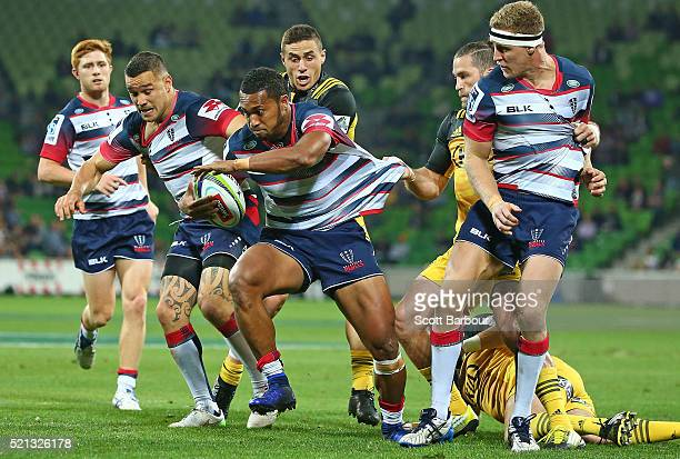 Sefa Naivalu of the Rebels is tackled during the round eight Super Rugby match between the Rebels and the Hurricanes at AAMI Park on April 15 2016 in...