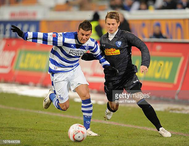 Sefa Yilmaz of Duisburg is challenged by Matthias Ostrzolek of Bochum during the Second Bundesliga match between MSV Duisburg and VfL Bochum at the...