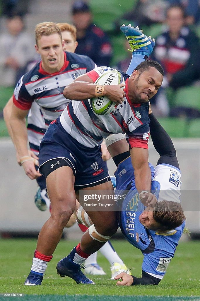 Sefanaia Naivalu of the Rebels breaks a tackle during the round 14 Super Rugby match between the Rebels and the Force at AAMI Park on May 29, 2016 in Melbourne, Australia.