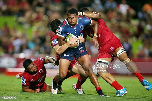Sefanaia Naivalu of the Rebels is tackled during the Super Rugby trial match between the Queensland Reds and the Melbourne Rebels at Barlow Park on...