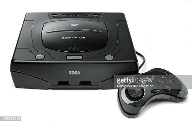A Sega Saturn video game console and controller photographed on a white background taken on March 26 2009
