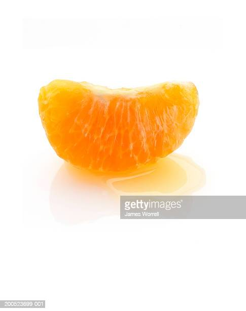 Segment of clementine on white background