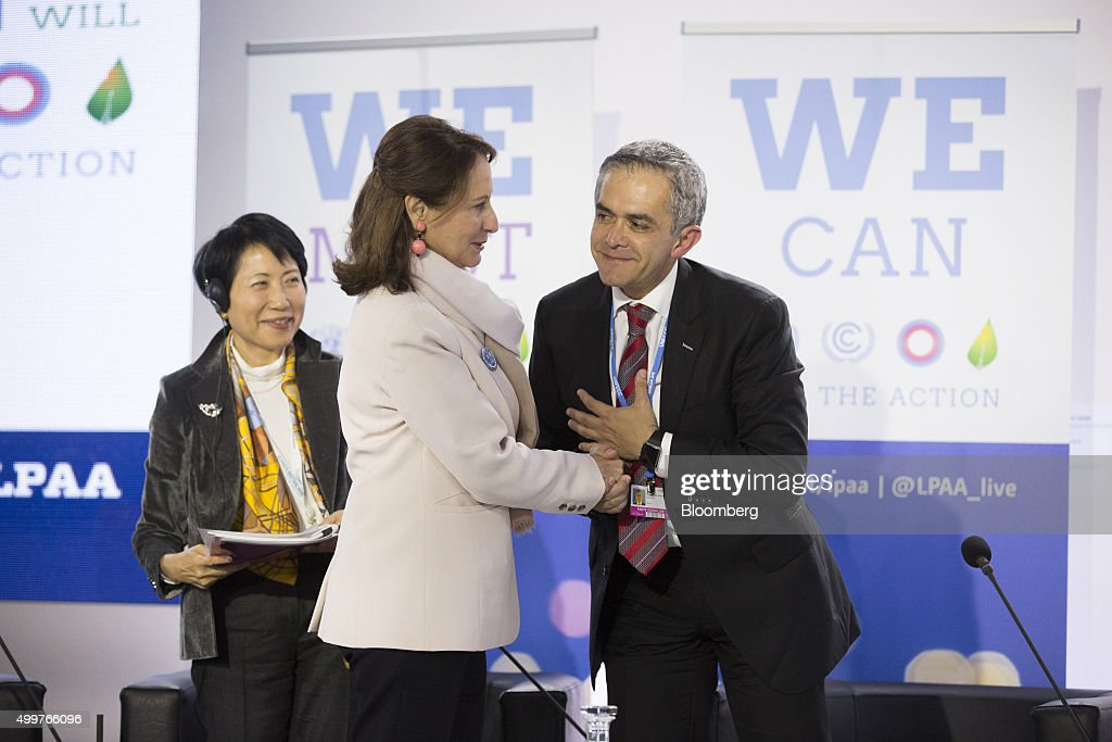 <a gi-track='captionPersonalityLinkClicked' href=/galleries/search?phrase=Segolene+Royal&family=editorial&specificpeople=546504 ng-click='$event.stopPropagation()'>Segolene Royal</a>, Frances environment minister, center, greets Miguel Angel Mancera, mayor of Mexico City, during a Lima-Paris Action Agenda (LPAA) news conference at the United Nations COP21 climate summit at Le Bourget in Paris, France, on Wednesday, Dec. 3, 2015. The two-week event, more than a year in the making, will draw about 137 heads of government and state, some 40,000 delegates including businessmen and celebrities. Photographer: Christophe Morin/Bloomberg via Getty Images