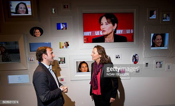 Segolene Royal French Minister for Ecology speaks with an unidentified individual at Google headquarters in Mountain View California on January 7...