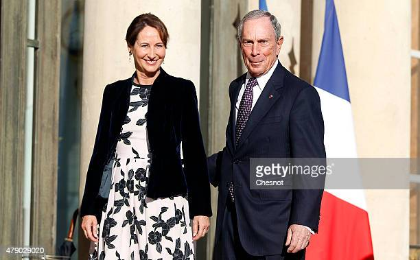 Segolene Royal French Minister of Ecology Sustainable Development and Energy welcomes Former New York city Mayor Michael Bloomberg prior to a meeting...