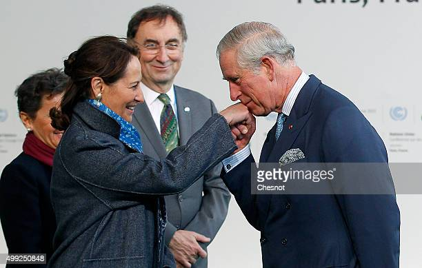 Segolene Royal French Minister of Ecology Sustainable Development and Energy welcomes Prince Charles Prince of Wales as he arrives for the COP21...