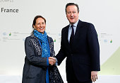 Segolene Royal French Minister of Ecology Sustainable Development and Energy welcomes British Prime Minister David Cameron as he arrives for the...