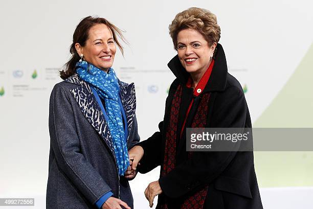 Segolene Royal French Minister of Ecology Sustainable Development and Energy welcomes Brasilian President Dilma Rousseff as he arrives for the COP21...