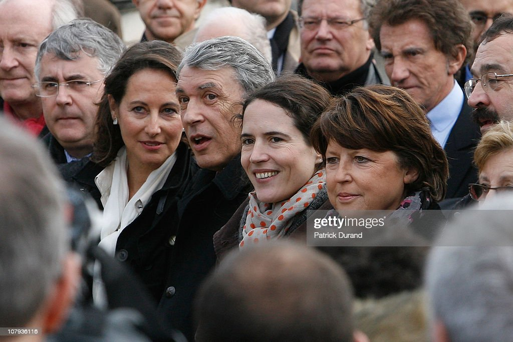 <a gi-track='captionPersonalityLinkClicked' href=/galleries/search?phrase=Segolene+Royal&family=editorial&specificpeople=546504 ng-click='$event.stopPropagation()'>Segolene Royal</a>, Gilbert Mitterrand, <a gi-track='captionPersonalityLinkClicked' href=/galleries/search?phrase=Mazarine+Pingeot&family=editorial&specificpeople=617344 ng-click='$event.stopPropagation()'>Mazarine Pingeot</a> and <a gi-track='captionPersonalityLinkClicked' href=/galleries/search?phrase=Martine+Aubry&family=editorial&specificpeople=590991 ng-click='$event.stopPropagation()'>Martine Aubry</a> attend a ceremony held for late French President Francois Mitterrand at Jarnac cemetery to mark the 15th anniversary of his death on January 8, 2011 in Jarnac, France. Francois Mitterrand was the fourth President of France to hold office under the Fifth Republic, from 1981-1995.