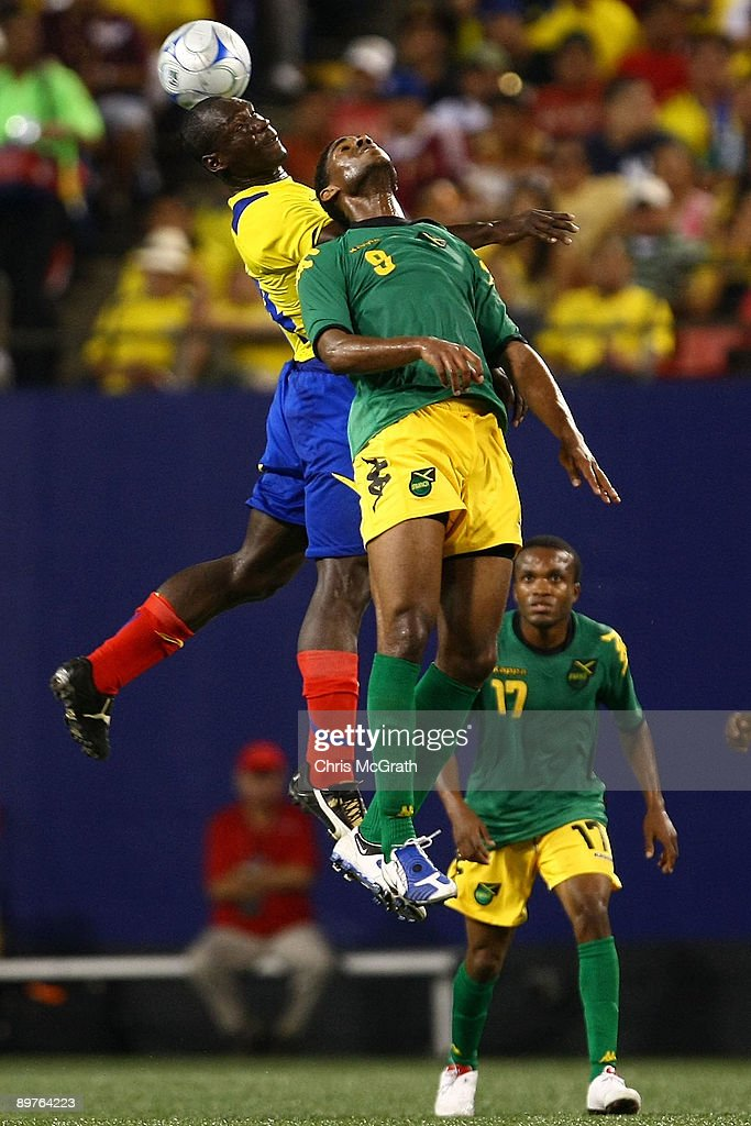 Segundo Castillo of Ecuador contests the ball with Khari Stephenson of Jamaica during their match at Giants Stadium on August 12 2009 in East...