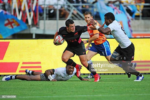 Segundo Tuculet of Argentina fends Jerry Tuwai of Fiji during the 2016 Wellington Sevens match between Argentina and Fiji at Westpac Stadium on...