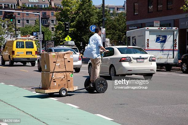 Segway PT Personal Transporter and trailer makes deliveries in North End Boston MA