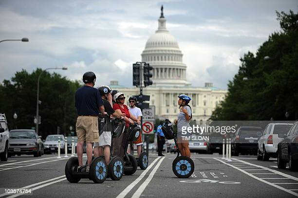A Segway tour group stops on the new Pennsylvania Avenue bicycle lanes near the US Capitol for some narration from their guide on August 2 2010 in...