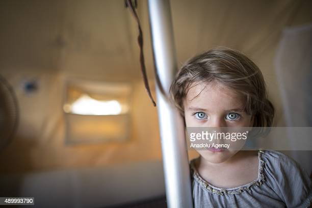 Sehat Fetih a Syrian refugee girl who fled Homs with her family is seen in her family's tent at a tent city in the Akcakale District of Sanliurfa...