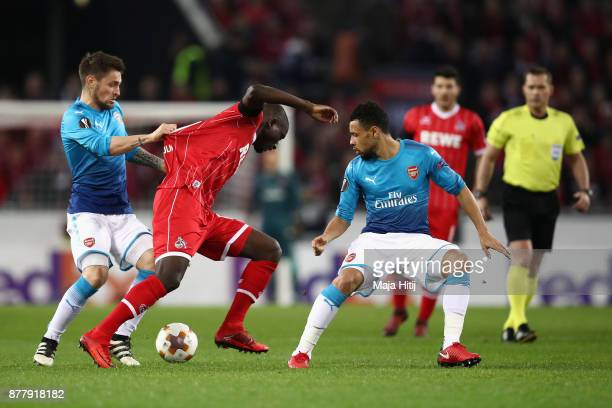Sehrou Guirassy of FC Koeln Mathieu Debuchy of Arsenal and Francis Coquelin of Arsneal in action during the UEFA Europa League group H match between...