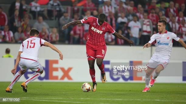 Sehrou Guirassy of Koeln and Marko Gobeljic of Belgrad and Srdjan Babic battle for the ball during the UEFA Europa League group H match between 1 FC...