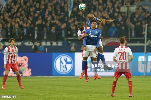 Sehrou Guirassy of Koeln and Weston McKennie of Schalke and Naldo of Schalke battle for the ball during the Bundesliga match between FC Schalke 04...