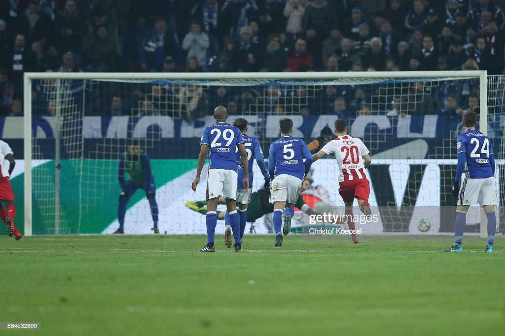 Sehrou Guirassy of Koeln (l) scores a goal from the penalty spot to make it 2:2 during the Bundesliga match between FC Schalke 04 and 1. FC Koeln at Veltins-Arena on December 2, 2017 in Gelsenkirchen, Germany.