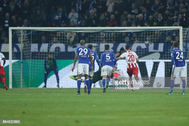 Sehrou Guirassy of Koeln scores a goal from the penalty spot to make it 22 during the Bundesliga match between FC Schalke 04 and 1 FC Koeln at...