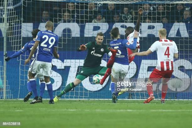 Sehrou Guirassy of Koeln scores a goal past goalkeeper Ralf Faehrmann of Schalke to make it 11 during the Bundesliga match between FC Schalke 04 and...