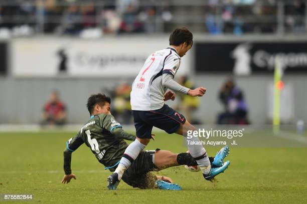 Sei Muroya of FC Tokyo and Akito Fukuta of Sagan Tosu compete for the ball during the JLeague J1 match between Sagan Tosu and FC Tokyo at Best...