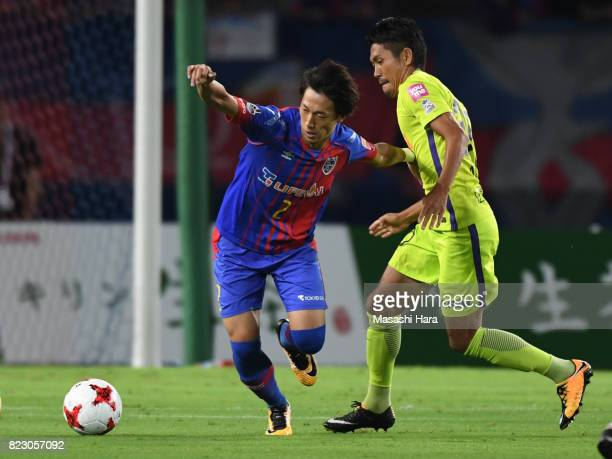 Sei Muroya of FC Tokyo and Kosei Shibasaki of Sanfrecce Hiroshima compete for the ball during the JLeague Levain Cup PlayOff Stage first leg match...