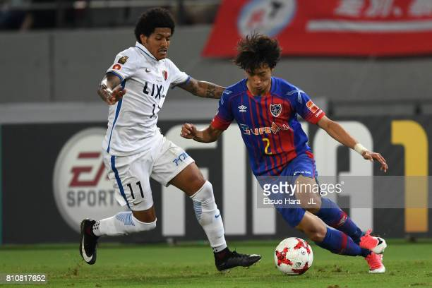 Sei Muroya of FC Tokyo and Leandro of Kashima Antlers compete for the ball during the JLeague J1 match between FC Tokyo and Kashima Antlers at...