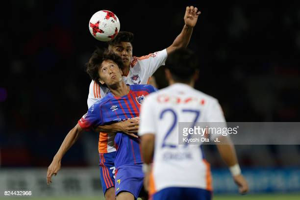 Sei Muroya of FC Tokyo and Romero Frank of Albirex Niigata compete for the ball during the JLeague J1 match between FC Tokyo and Albirex Niigata at...