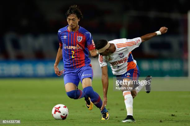 Sei Muroya of FC Tokyo and Rony of Albirex Niigata compete for the ball during the JLeague J1 match between FC Tokyo and Albirex Niigata at Ajinomoto...